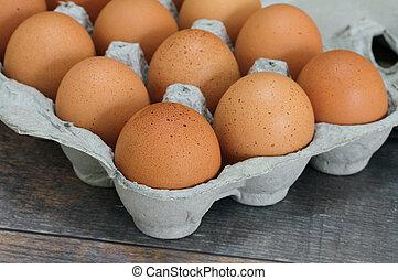 Brown eggs in an egg carton. Macro with selective focus.