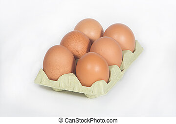 Brown Eggs - Cardboard egg box with six brown eggs isolated...