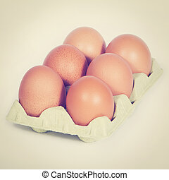 Brown Eggs - Cardboard egg box with six brown eggs retro...