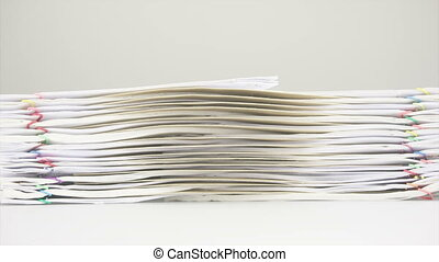Brown envelope between overload of old paperwork place on...