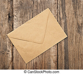brown envelope on old wooden background