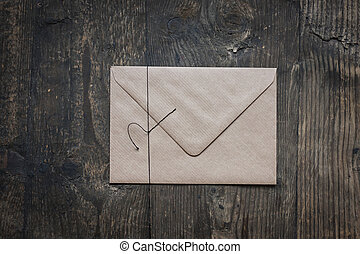 brown envelope on wooden background