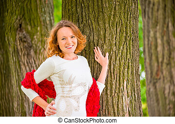brown-eyed red-haired beautiful girl portrait in the park