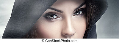 Brown eyes looking at camera. - Closeup beauty portrait of...