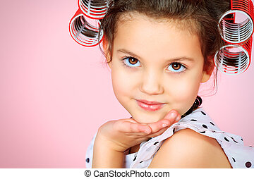 brown eyes - Portrait of a cute little pin-up girl over pink...