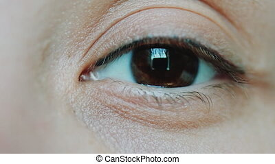 Brown eyes women looking at the camera - Brown eyes of a...