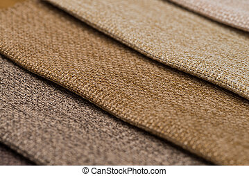 Closeup detail of brown fabric texture background.