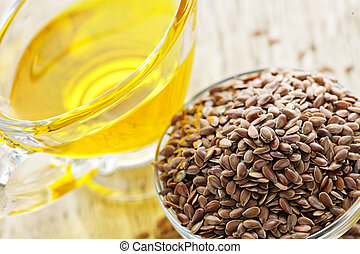 Brown flax seed and linseed oil - Bowl of brown flax seed...