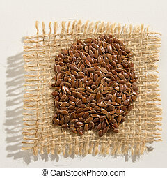 Brown Flax seed. Close up of grains over burlap.