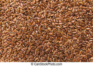 Brown Flax seed. Closeup of grains, background use.