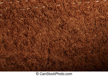 Brown fluffy background with stitches