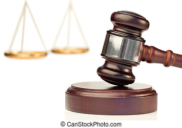 Brown gavel and scale of justice on a white background