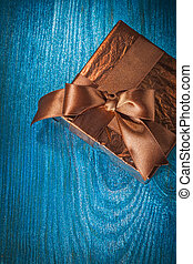 brown gift box on blue background