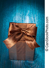 brown gift box on blue board