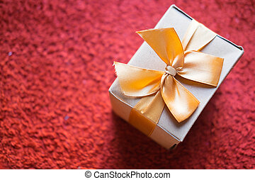 Brown gift box with golden ribbon