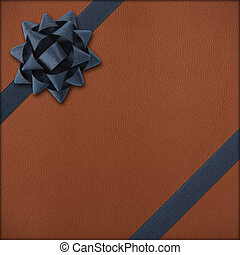 Brown gift with dark bow