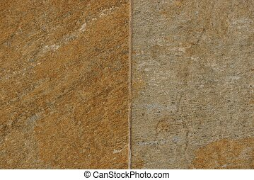brown gray stone background from an old wall on the facade of a building