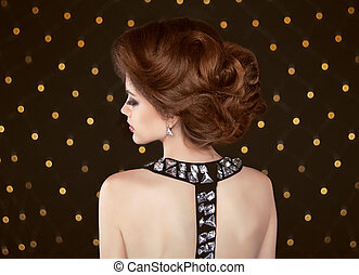 Brown hair. Beautiful elegant woman with hairstyle. Fashion girl
