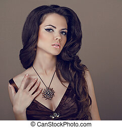 Brown Hair Styling. Beautiful Woman with Healthy Long Hair