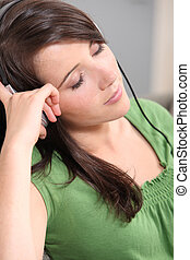 brown-haired girl listening to music
