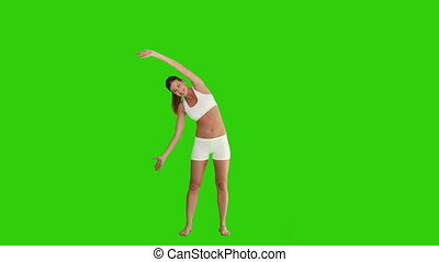 Brown-haired woman doing exercise in sportswear