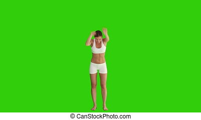 Brown-haired woman in sportswear doing exercise