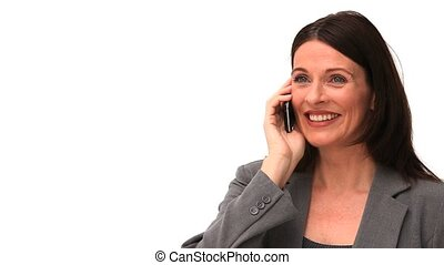 Brown-haired woman laughing on the phone