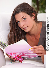 brown-haired woman looking at photos