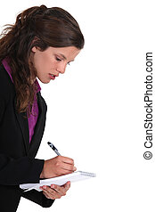 Brown-haired woman writing on a notepad