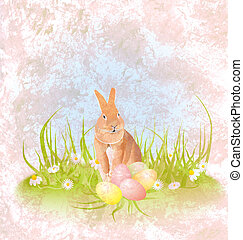 brown hare or rabbit sitting in the grass with easter eggs and daisies grunge