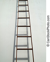 Brown iron ladder on white wall