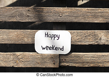 Brown label with text Happy weekend on wood background