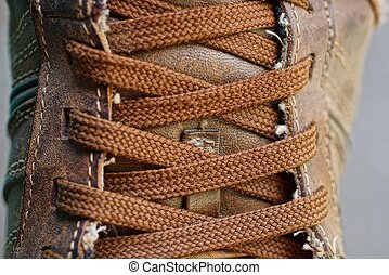 brown lace-up fabric lacing on boot