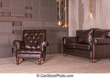 Brown leather armchair and vintage leather sofa. interior composition.retro furniture. Creative design. Copy space