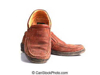 Brown leather men's shoes with wooden shoe stretchers on the sid