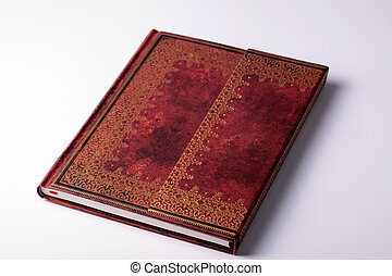brown leather old note book with gold ornament