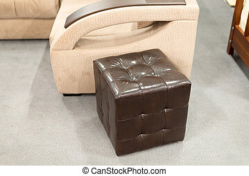 Brown leather ottoman in interior of the apartment