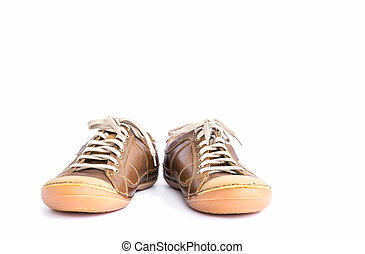 Brown leather shoes on white background.