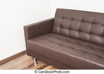 brown leather sofa in room