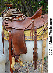 brown leather tack saddle rope