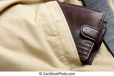 wallet in the back pocket of casual pants