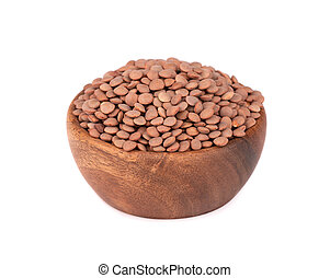 Brown lentils in wooden bowl, isolated on white background.