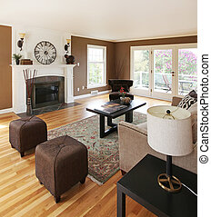 Brown livinng room with white fireplace and luxury...