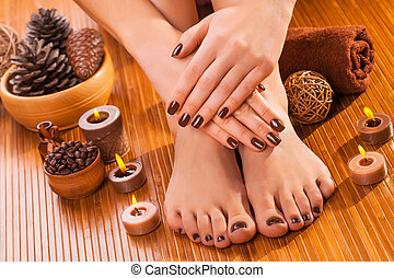 brown manicure and pedicure on the bamboo - beautiful brown...