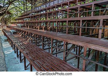 Brown metal grandstand - Perspective view of brown metal...