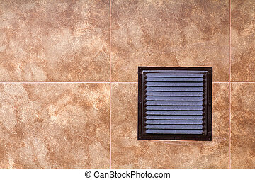 Brown metal industrial panel with ventilation grilles, closeup photo, front view. Detail of architecture design. Air circulation system.