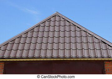 brown metal tile on the roof of a house