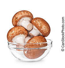 brown mushrooms in a glass bowl isolated on white background