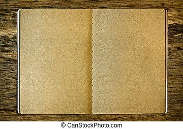 Brown notepad on the wood background
