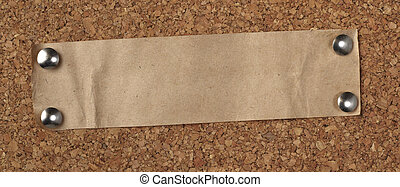 brown old paper note background cork board - closeup of note...